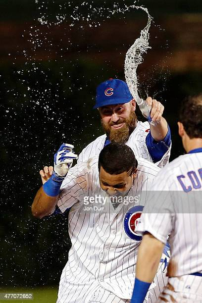 Jason Motte of the Chicago Cubs dumps water on Starlin Castro after he hit a walkoff one run RBI single against the Cincinnati Reds at Wrigley Field...