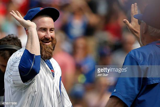 Jason Motte of the Chicago Cubs high fives manager Joe Maddon after their win over the Miami Marlins at Wrigley Field on July 5 2015 in Chicago...