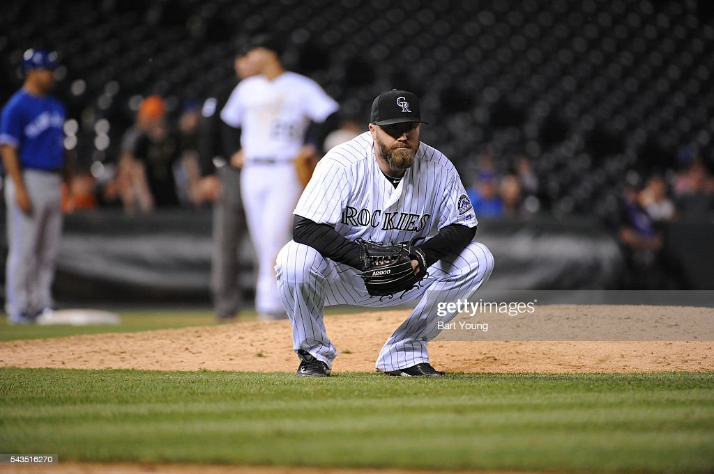 Jason Motte #30 of the Colorado Rockies reacts to an error in the eighth inning against the Toronto Blue Jays at Coors Field on June 28, 2016 in Denver, Colorado. The Toronto Blue Jays defeat the Colorado Rockies 14-9.