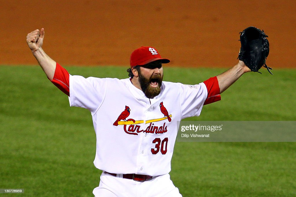 Jason Motte of the St Louis Cardinals celebrates after defeating the Texas Rangers 62 to win the World Series in Game Seven of the MLB World Series...
