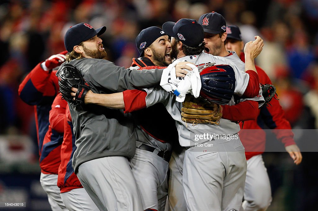 Jason Motte of the St Louis Cardinals celebrates with teammates after the Cardinals defeat the Washington Nationals 97 in Game Five of the National...