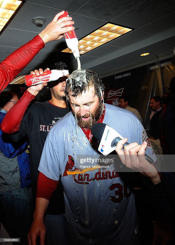 <a gi-track='captionPersonalityLinkClicked' href=/galleries/search?phrase=Jason+Motte&family=editorial&specificpeople=803364 ng-click='$event.stopPropagation()'>Jason Motte</a> #30 of the St. Louis Cardinals is doused by his teammates in the locker room after the Cardinals defeated the Washington Nationals 9-7 in Game Five of the National League Division Series at Nationals Park on October 12, 2012 in Washington, DC.