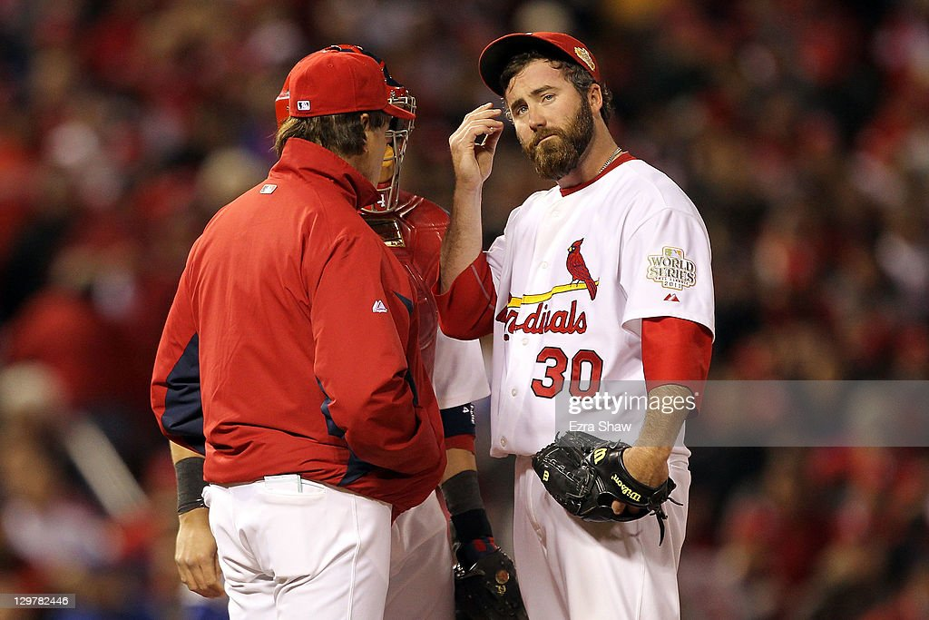 Jason Motte of the St Louis Cardinals reacts after allowing the tying run in the ninth inning and getting removed from the game by manager Tony La...