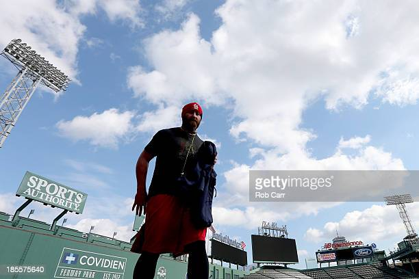 Jason Motte of the St Louis Cardinals walks in left field during 2013 World Series Media Day at Fenway Park on October 22 2013 in Boston...