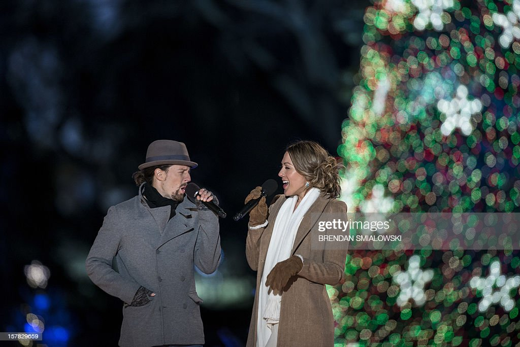 Jason Mraz and Colbie Caillat perform during the 90th annual National Christmas Tree Lighting on the Ellipse of the National Mall December 6, 2012 in Washington, DC.