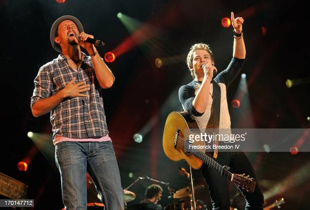 Jason Mraz performs with Hunter Hayes at LP Field during the 2013 CMA Music Festival on June 7 2013 in Nashville Tennessee