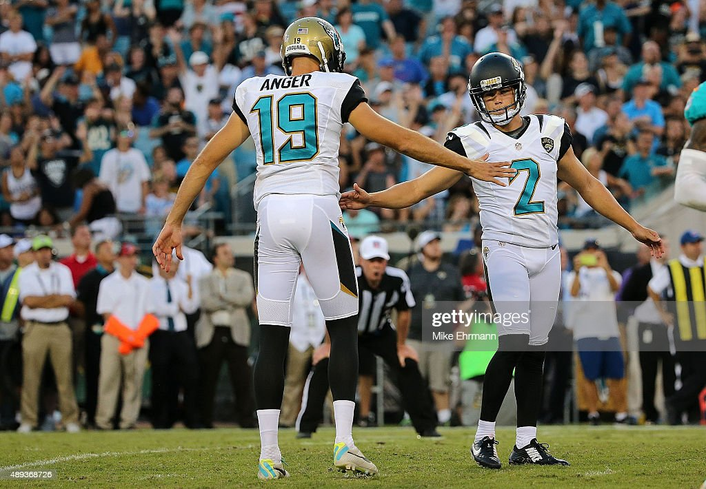 Jason Myers of the Jacksonville Jaguars is congratulated by Bryan Anger after kicking the game winning field goal during a game against the Miami...