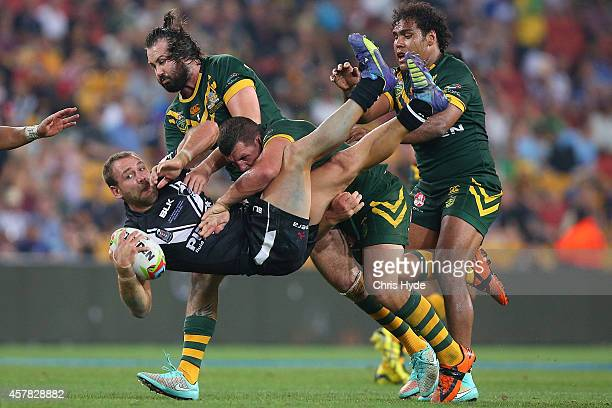 Jason Nightingale of New Zealand is tackled by Greg Bird of Australia during the Four Nations Rugby League match between the Australian Kangaroos and...