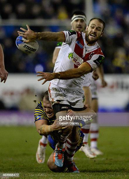 Jason Nightingale of St George Illawarra Dragons is tackled by Ben Westwood of Warrington Wolves during the World Club Series match between...