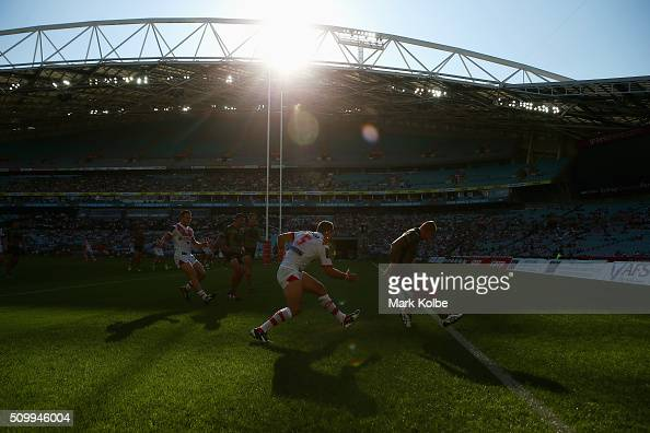Jason Nightingale of the Dragons and Aaron Gray of the Rabbitohs compete for the ball in the ingoal area during the NRL Charity Shield match between...