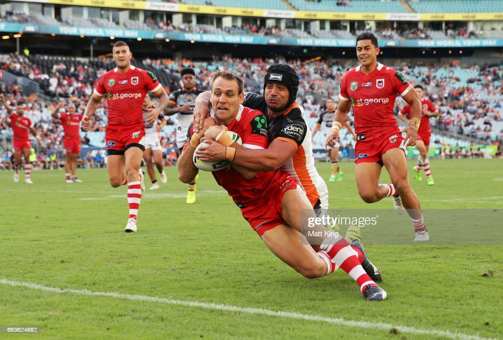 Jason Nightingale of the Dragons beats David Nofoaluma of the Tigers to score a try during the round five NRL match between the Wests Tigers and the St George Illawarra Dragons at ANZ Stadium on April 2, 2017 in Sydney, Australia.