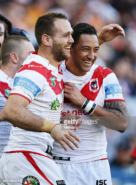 Jason Nightingale of the Dragons celebrates with Benji Marshall after scoring a try during the round 20 NRL match between the Wests Tigers and the St...