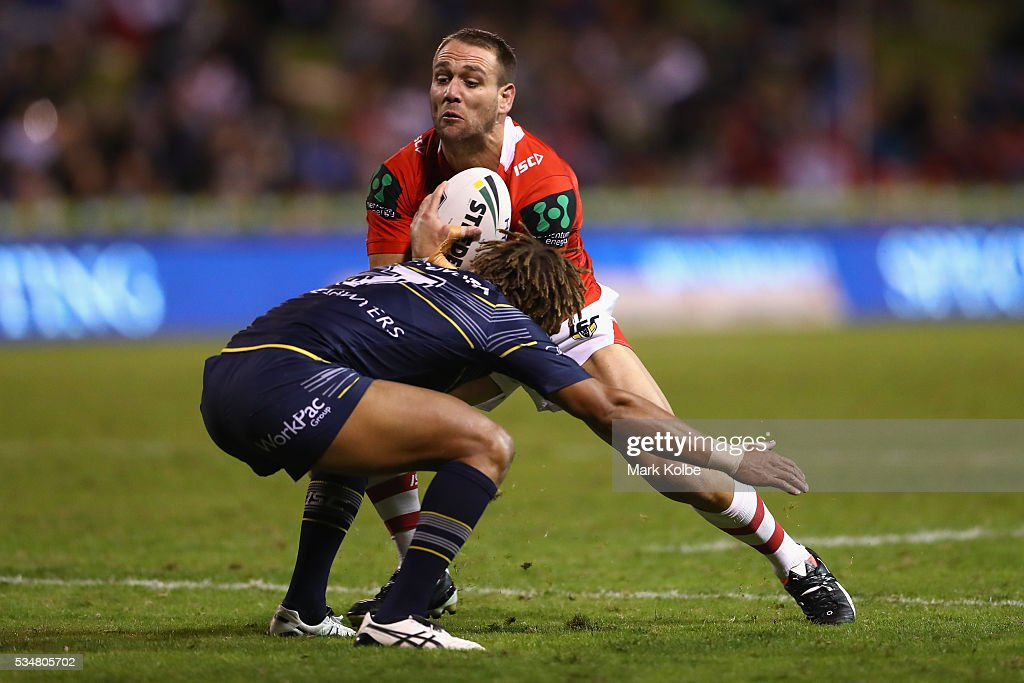 Jason Nightingale of the Dragons is tackled by Ray Thompson of the Cowboys during the round 12 NRL match between the St George Illawarra Dragons and the North Queensland Cowboys at WIN Jubilee Stadium on May 28, 2016 in Wollongong, Australia.