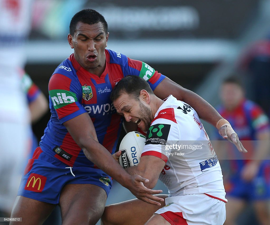 Jason Nightingale of the Dragons is tackled by the Knights defence during the round 16 NRL match between the Newcastle Knights and the St George Illawarra Dragons at Hunter Stadium on June 25, 2016 in Newcastle, Australia.