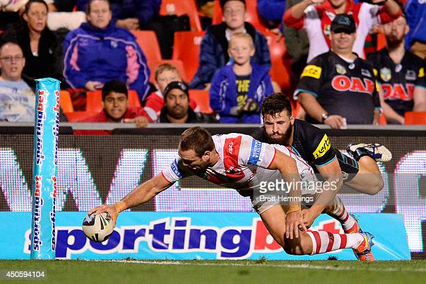 Jason Nightingale of the Dragons reaches for the try line to score during the round 14 NRL match between the Penrith Panthers and the St George...
