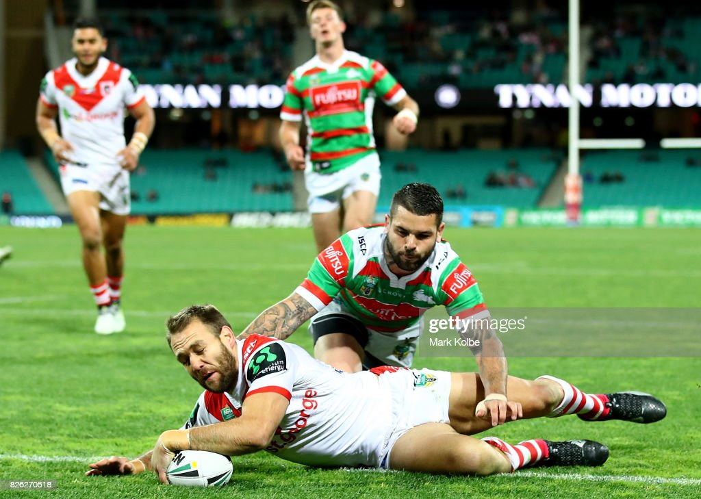 Jason Nightingale of the Dragons scores a try as he avoids a tackle from Adam Reynolds of the Rabbitohs during the round 22 NRL match between the St George Illawarra Dragons and the South Sydney Rabbitohs at Sydney Cricket Ground on August 4, 2017 in Sydney, Australia.