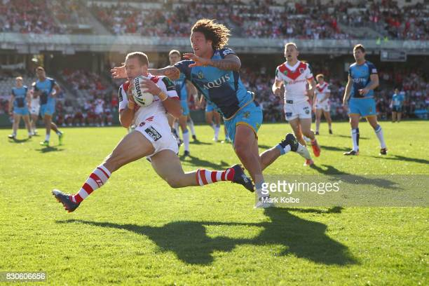 Jason Nightingale of the Dragons scores a try under pressure from Kevin Proctor of the Titans during the round 23 NRL match between the St George...