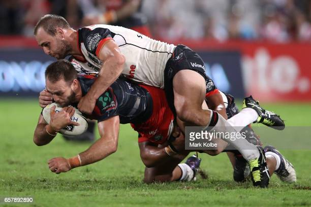 Jason Nightingale sd is tackled by Simon Mannering of the Warriors during the round four NRL match between the St George Illawarra Dragons and the...