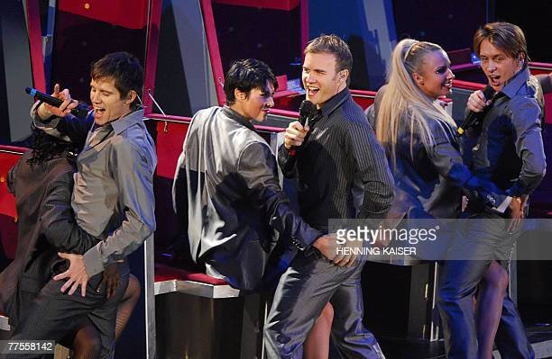 Jason Orange Gary Barlow and Mark Owen of the British group Take That perform on stage 29 October 2007 in Cologne western Germany during the first...