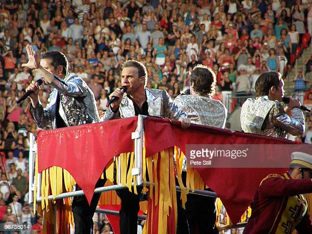Jason Orange Gary Barlow Howard Donald and Mark Owen of Take That perform on board a giant mechanical elephant on the final date of their 'Circus'...