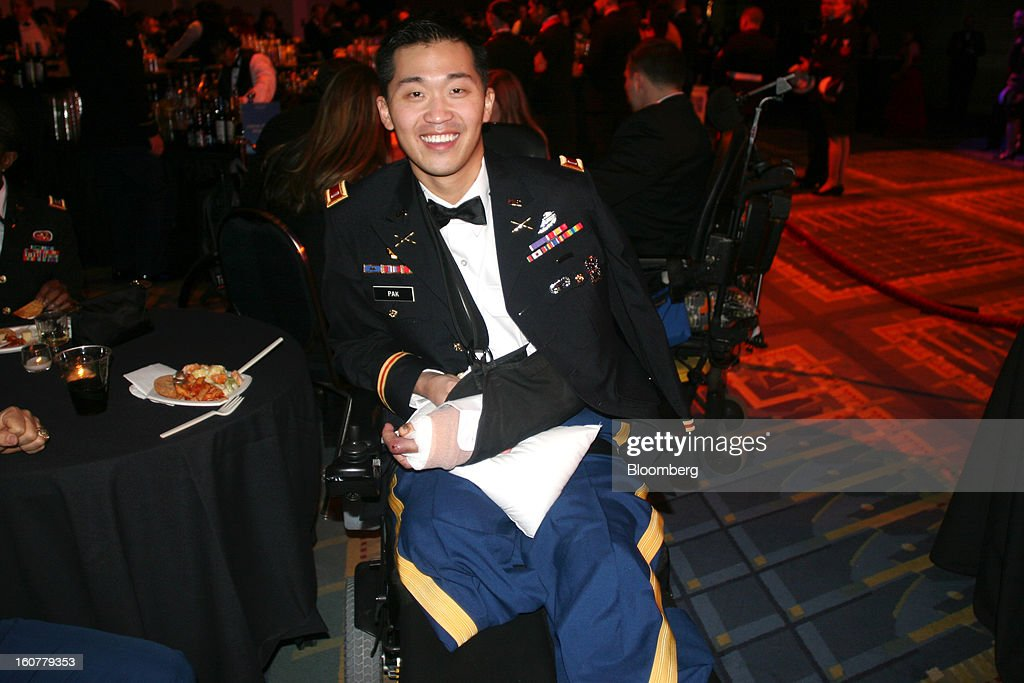 Jason Pak, first lieutenant in the U.S. Army who was injured in December 2012 in Afghanistan, attends the Commander-in-Chief Ball at the Walter E. Washington Convention Center in Washington, D.C., U.S., on Monday, Jan. 21, 2013. President Obama was sworn in for his second term earlier in the day. Photographer: Stephanie Green/Bloomberg via Getty Images