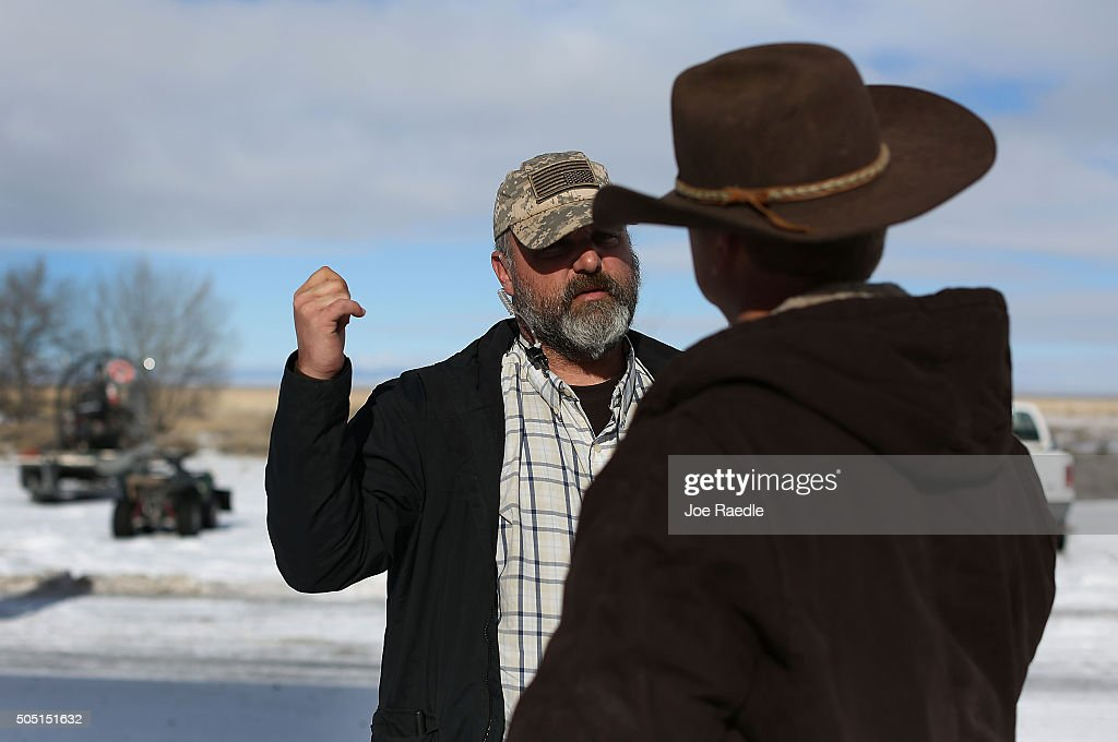 Jason Patrick and Ryan Bundy one of the protest leaders talk as they join other protesters at the Malheur National Wildlife Refuge on January 15 2016...