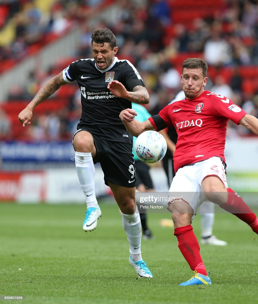Jason Pearce of Charlton clears the ball under pressure from Marc Richards of Northampton Town during the Sky Bet League One match between Charlton Athletic and Northampton Town at The Valley on August 19, 2017 in London, England.