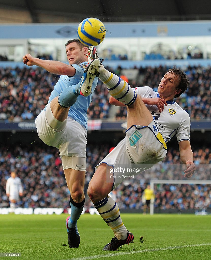 Jason Pearce of Leeds United competes for the ball with <a gi-track='captionPersonalityLinkClicked' href=/galleries/search?phrase=James+Milner+-+Soccer+Player&family=editorial&specificpeople=214576 ng-click='$event.stopPropagation()'>James Milner</a> of Manchester City during the FA Cup with Budweiser Fifth Round match between Manchester City and Leeds United at the Etihad Stadium on February 17, 2013 in Manchester, England.