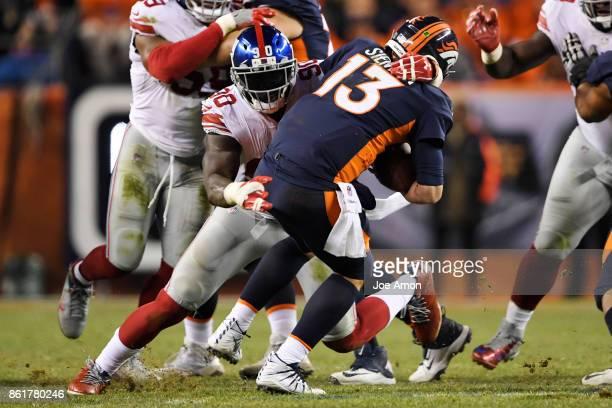 Jason PierrePaul of the New York Giants sacks Trevor Siemian of the Denver Broncos during the fourth quarter of the on Sunday October 15 2017 The...