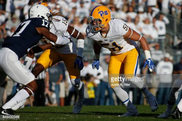 Jason Pinnock and Jim Medure of the Pittsburgh Panthers in action against the Penn State Nittany Lions at Beaver Stadium on September 9 2017 in State...