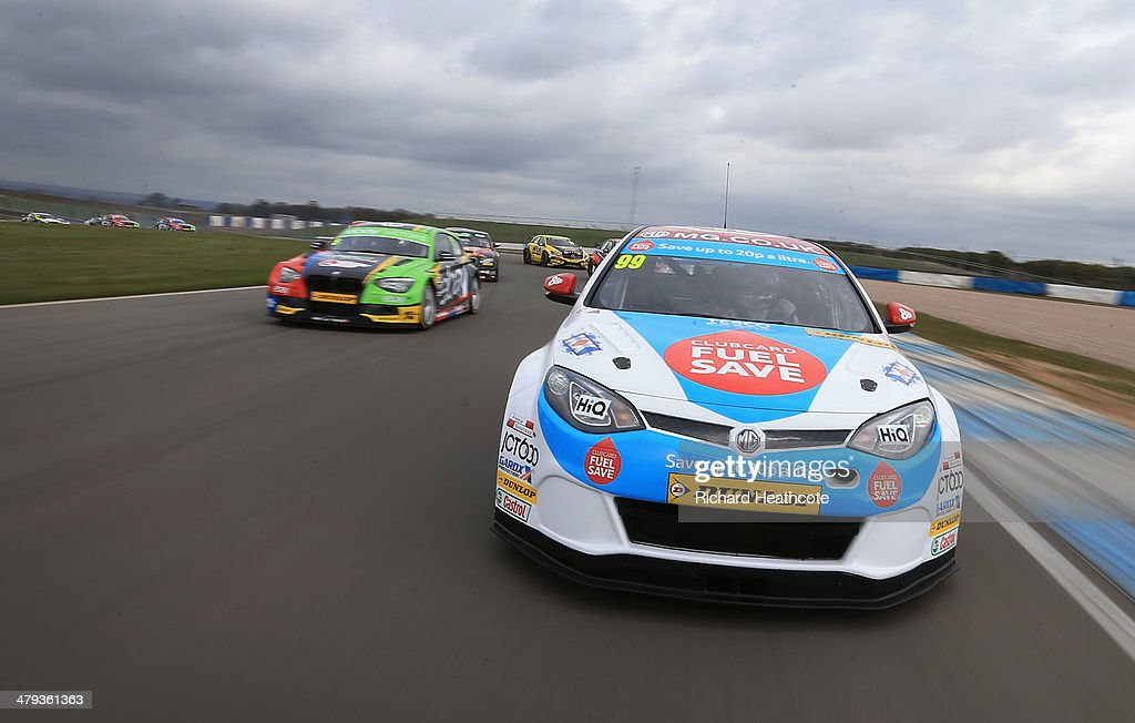 Jason Plato in the MG KX Clubcard Fuel Save MG6 leads the pack around on a display lap during the 2014 Dunlop MSA British Touring Car Championship media day at Donington Park on March 18, 2014 in Castle Donington, England.