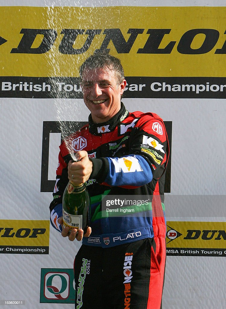 Jason Plato of Great Britain, driver of the #99 MG KX Momentum Racing MG6 sprays champagne as he celebrates winning the Dunlop MSA British Touring Car Championship race at the Silverstone Circuit on October 7, 2012 in Towcester, United Kingdom.