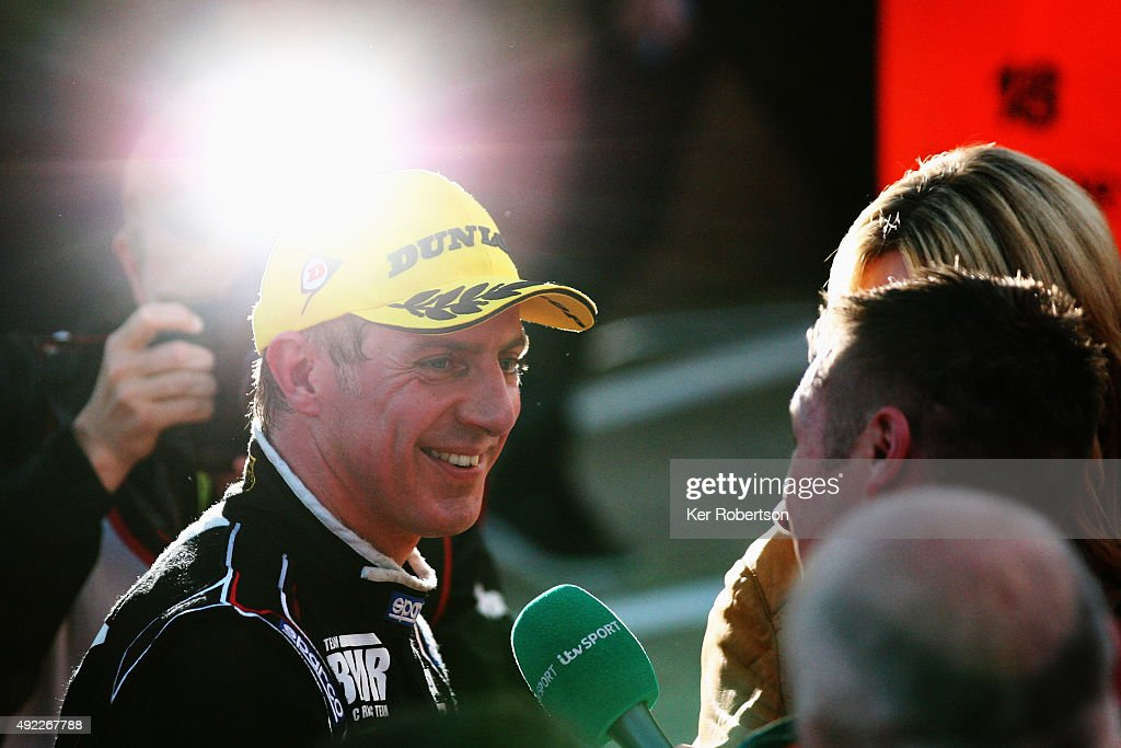 Jason Plato of Team BMR congratulates Gordon Shedden of Honda Racing for winning the overall championship after the Final Round of the Dunlop MSA British Touring Car Championship at Brands Hatch on October 11, 2015 in Longfield, England.