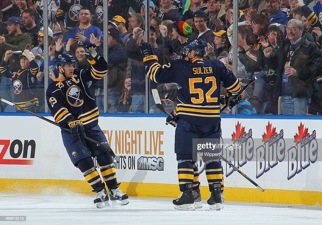 Jason Pominville #29 and Alexander Sulzer #52 of the Buffalo Sabres celebrate a goal against the Florida Panthers on February 3, 2013 at the First Niagara Center in Buffalo, New York.