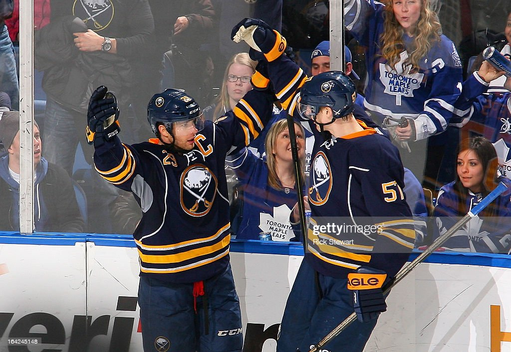 Jason Pominville #29 and Tyler Myers #57 of the Buffalo Sabres celebrate Pominville's game-tying goal in the second period at First Niagara Center on March 21, 2013 in Buffalo, United States.