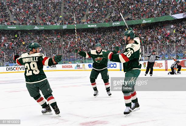 Jason Pominville Mike Reilly and Thomas Vanek of the Minnesota Wild react after Vanek scored in the first period against the Chicago Blackhawks...