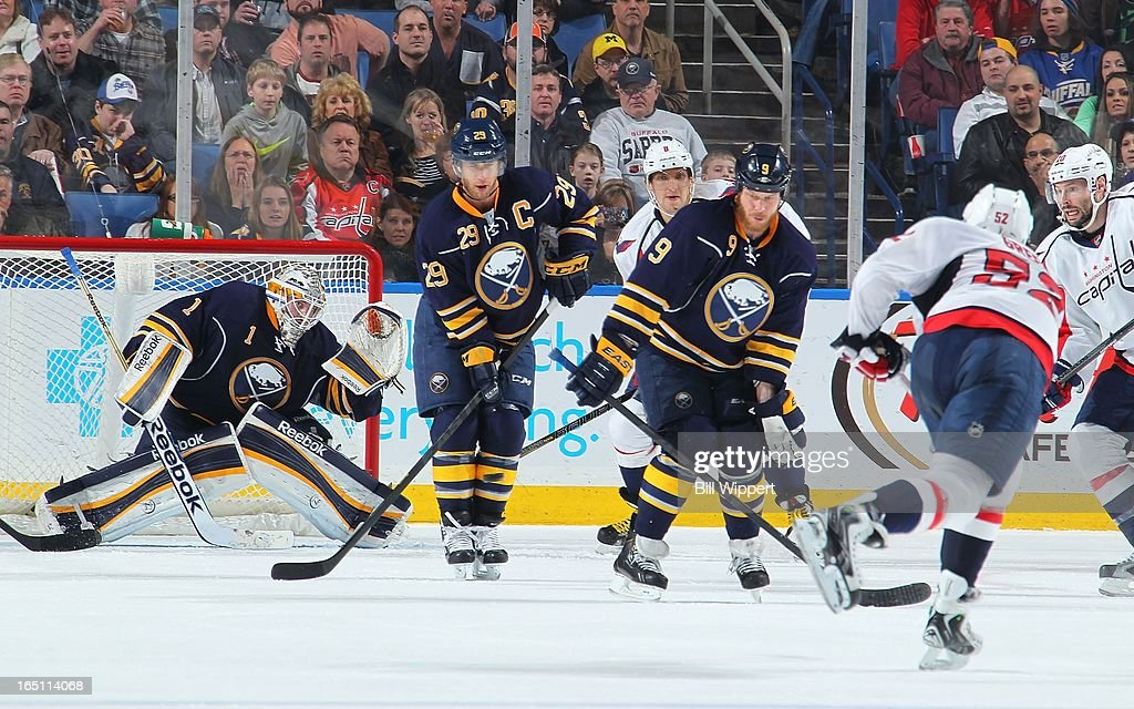 <a gi-track='captionPersonalityLinkClicked' href=/galleries/search?phrase=Jason+Pominville&family=editorial&specificpeople=570525 ng-click='$event.stopPropagation()'>Jason Pominville</a> #29 of the Buffalo Sabres cannot block a third period shot from Mike Green #52 of the Washington Capitals and gets past goaltender <a gi-track='captionPersonalityLinkClicked' href=/galleries/search?phrase=Jhonas+Enroth&family=editorial&specificpeople=570456 ng-click='$event.stopPropagation()'>Jhonas Enroth</a> #1 of the Sabres to tie the game on March 30, 2013 at the First Niagara Center in Buffalo, New York. Washington defeated Buffalo, 4-3.