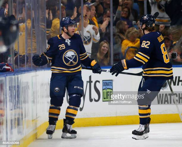 Jason Pominville of the Buffalo Sabres celebrates his goal against the Montreal Canadiens with Nathan Beaulieu during the first period at the KeyBank...