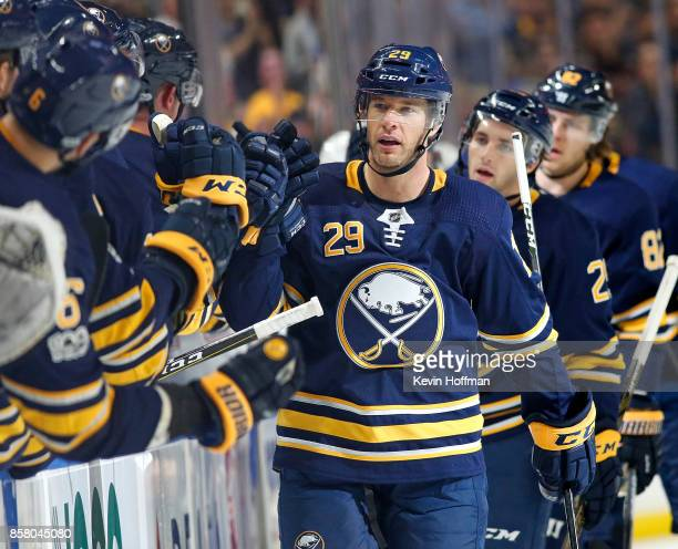 Jason Pominville of the Buffalo Sabres celebrates with the bench after scoring a goal against the Montreal Canadiens during the first period at the...