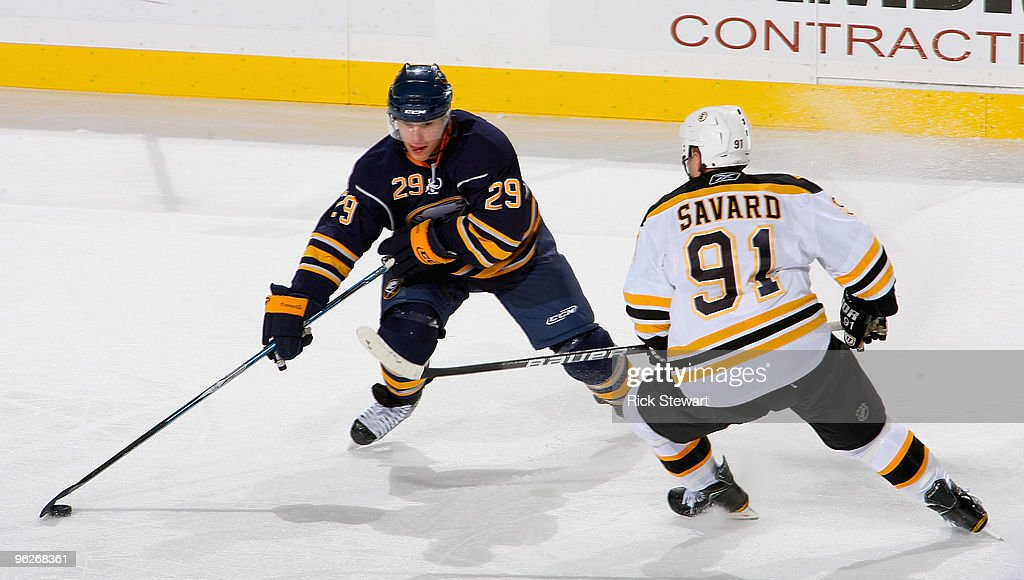 Jason Pominville #29 of the Buffalo Sabres dekes around Marc Savard #91 of the Boston Bruins at HSBC Arena on January 29, 2010 in Buffalo, New York.