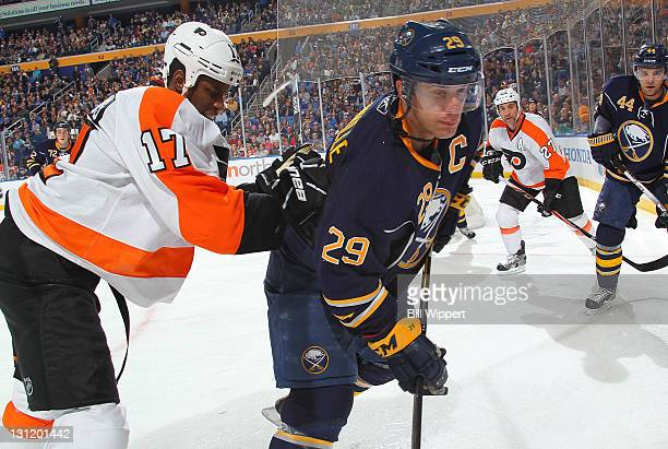 Jason Pominville of the Buffalo Sabres gets checked into the boards by Wayne Simmonds of the Philadelphia Flyers at First Niagara Center on November...
