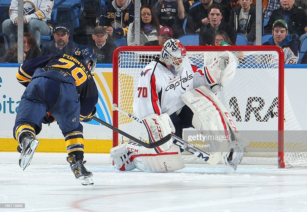 <a gi-track='captionPersonalityLinkClicked' href=/galleries/search?phrase=Jason+Pominville&family=editorial&specificpeople=570525 ng-click='$event.stopPropagation()'>Jason Pominville</a> #29 of the Buffalo Sabres has his shot hit the goalpost in a shootout attempt against <a gi-track='captionPersonalityLinkClicked' href=/galleries/search?phrase=Braden+Holtby&family=editorial&specificpeople=5370964 ng-click='$event.stopPropagation()'>Braden Holtby</a> #70 of the Washington Capitals on March 30, 2013 at the First Niagara Center in Buffalo, New York. Washington defeated Buffalo, 4-3.