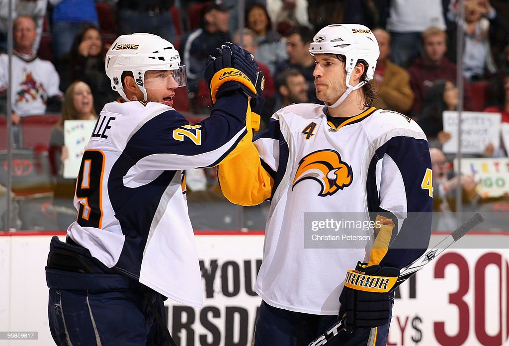 <a gi-track='captionPersonalityLinkClicked' href=/galleries/search?phrase=Jason+Pominville&family=editorial&specificpeople=570525 ng-click='$event.stopPropagation()'>Jason Pominville</a> #29 of the Buffalo Sabres is congratulated by teammate <a gi-track='captionPersonalityLinkClicked' href=/galleries/search?phrase=Steve+Montador&family=editorial&specificpeople=208775 ng-click='$event.stopPropagation()'>Steve Montador</a> #4 after Pominville scored a third period goal against the Phoenix Coyotes during the NHL game at Jobing.com Arena on January 18, 2010 in Glendale, Arizona. The Sabres defeated the Coyotes 7-2.