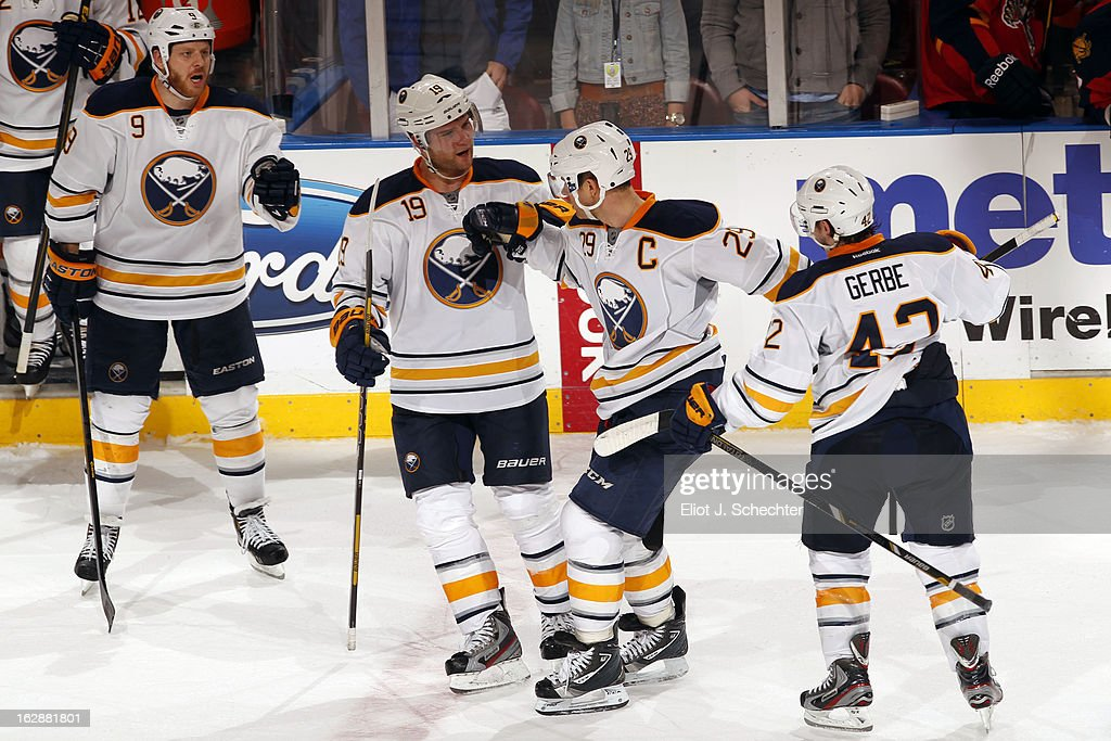 Jason Pominville #29 of the Buffalo Sabres is congratulated by teammates after scoring the game winning goal in a shootout against Goaltender Jose Theodore #60 of the Florida Panthers at the BB&T Center on February 28, 2013 in Sunrise, Florida.