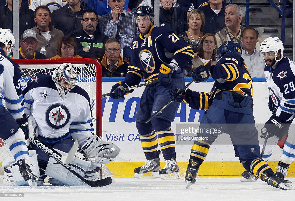 <a gi-track='captionPersonalityLinkClicked' href=/galleries/search?phrase=Jason+Pominville&family=editorial&specificpeople=570525 ng-click='$event.stopPropagation()'>Jason Pominville</a> #29 of the Buffalo Sabres is stopped by Ondrej Pavelec #31 of the Winnipeg Jets as <a gi-track='captionPersonalityLinkClicked' href=/galleries/search?phrase=Drew+Stafford&family=editorial&specificpeople=220617 ng-click='$event.stopPropagation()'>Drew Stafford</a> #21 of the Buffalo Sabres looks on during their NHL game at First Niagara Center November 8, 2011 in Buffalo, New York.