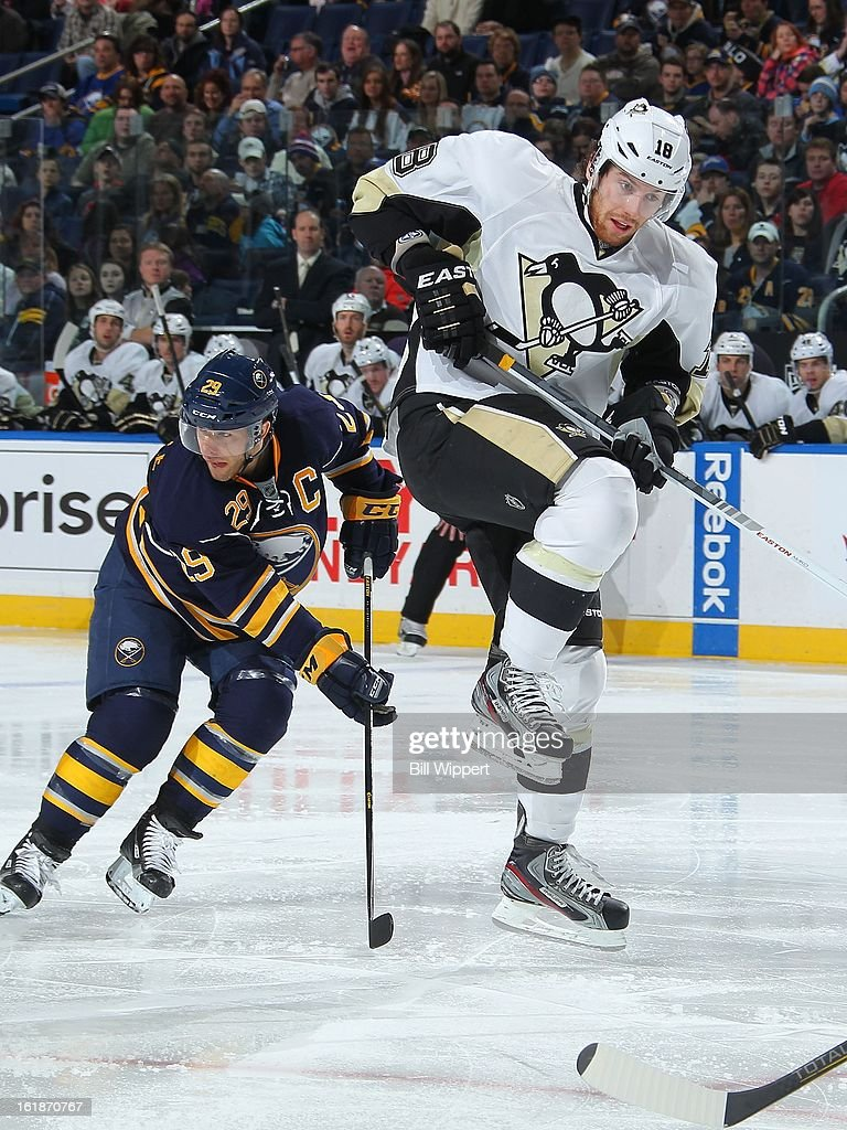 <a gi-track='captionPersonalityLinkClicked' href=/galleries/search?phrase=Jason+Pominville&family=editorial&specificpeople=570525 ng-click='$event.stopPropagation()'>Jason Pominville</a> #29 of the Buffalo Sabres keeps a close eye on the puck as <a gi-track='captionPersonalityLinkClicked' href=/galleries/search?phrase=James+Neal&family=editorial&specificpeople=1487991 ng-click='$event.stopPropagation()'>James Neal</a> #18 of the Pittsburgh Penguins jumps to avoid a second period shot on February 17, 2013 at the First Niagara Center in Buffalo, New York.