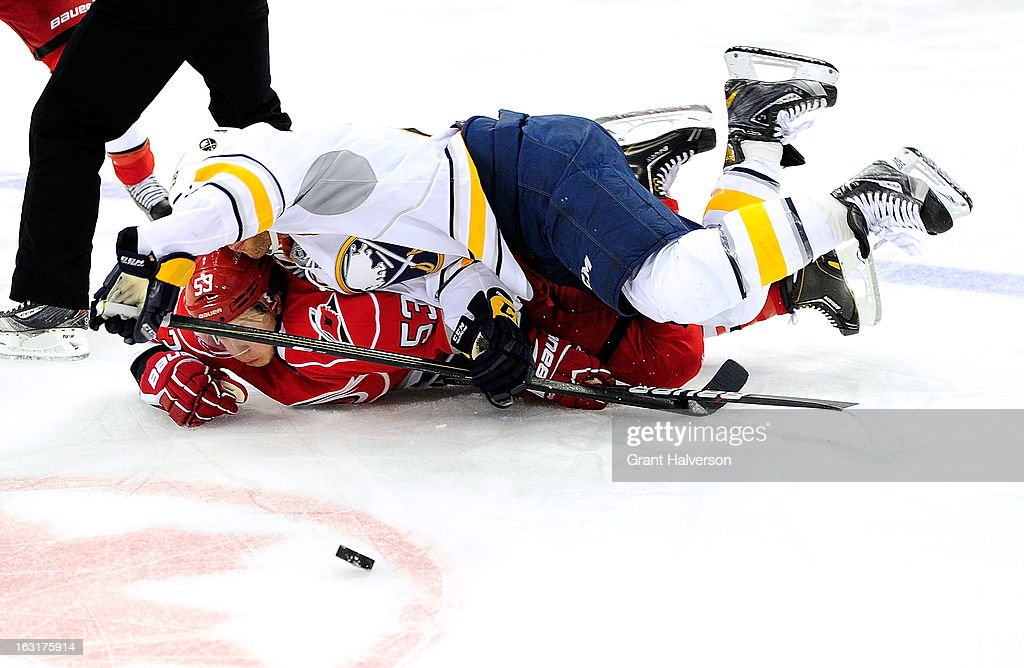 <a gi-track='captionPersonalityLinkClicked' href=/galleries/search?phrase=Jason+Pominville&family=editorial&specificpeople=570525 ng-click='$event.stopPropagation()'>Jason Pominville</a> #29 of the Buffalo Sabres lands on <a gi-track='captionPersonalityLinkClicked' href=/galleries/search?phrase=Jeff+Skinner&family=editorial&specificpeople=3147596 ng-click='$event.stopPropagation()'>Jeff Skinner</a> #53 of the Carolina Hurricanes as they battle for the puck during play at PNC Arena on March 5, 2013 in Raleigh, North Carolina.