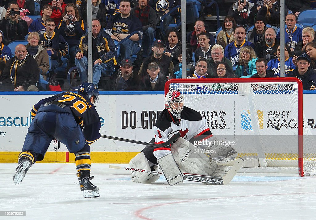 <a gi-track='captionPersonalityLinkClicked' href=/galleries/search?phrase=Jason+Pominville&family=editorial&specificpeople=570525 ng-click='$event.stopPropagation()'>Jason Pominville</a> #29 of the Buffalo Sabres scores a goal in the shootout against <a gi-track='captionPersonalityLinkClicked' href=/galleries/search?phrase=Johan+Hedberg&family=editorial&specificpeople=202078 ng-click='$event.stopPropagation()'>Johan Hedberg</a> #1 of the New Jersey Devils on March 2, 2013 at the First Niagara Center in Buffalo, New York. Buffalo defeated New Jersey, 4-3.