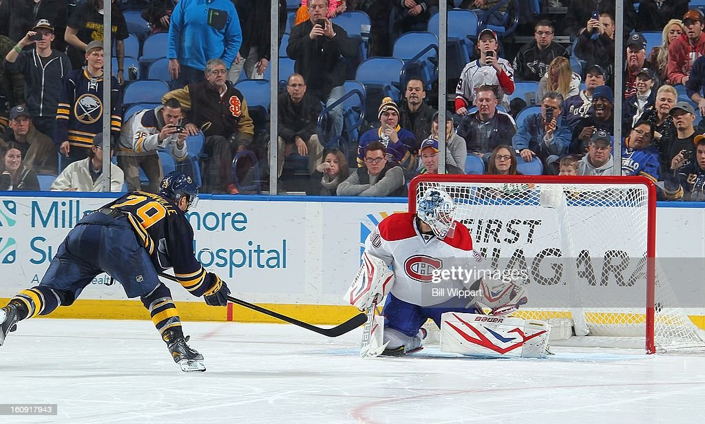 <a gi-track='captionPersonalityLinkClicked' href=/galleries/search?phrase=Jason+Pominville&family=editorial&specificpeople=570525 ng-click='$event.stopPropagation()'>Jason Pominville</a> #29 of the Buffalo Sabres scores a shootout goal against <a gi-track='captionPersonalityLinkClicked' href=/galleries/search?phrase=Peter+Budaj&family=editorial&specificpeople=228123 ng-click='$event.stopPropagation()'>Peter Budaj</a> #30 of the Montreal Canadiens on February 7, 2013 at the First Niagara Center in Buffalo, New York. Buffalo defeated Montreal, 4-3, in an overtime shootout.