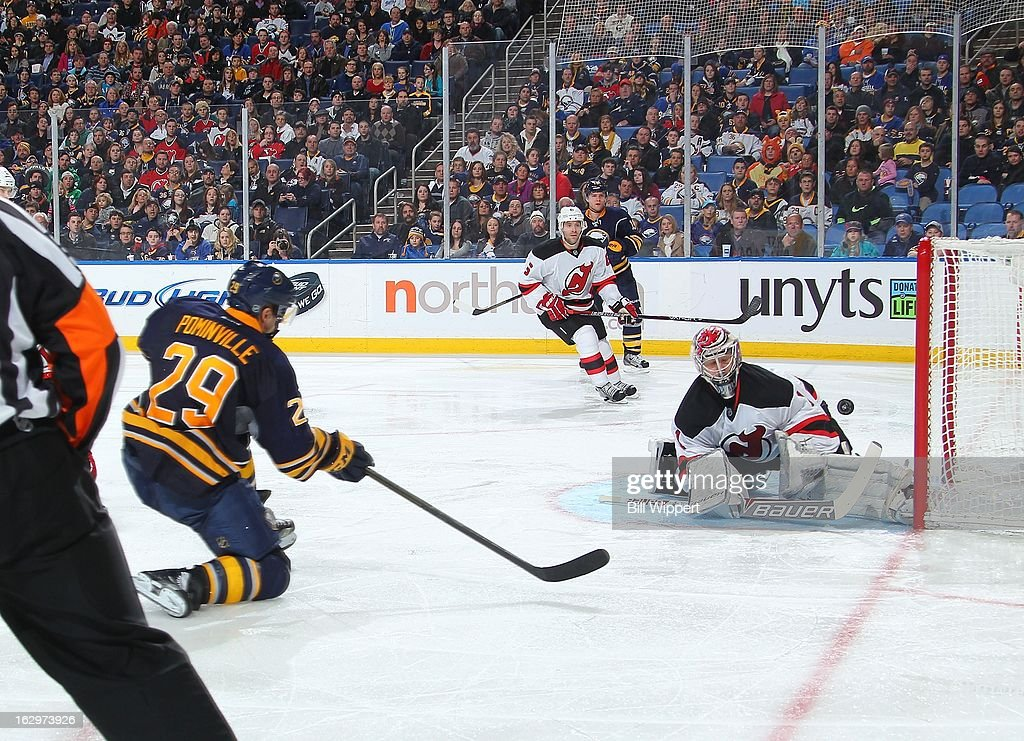 <a gi-track='captionPersonalityLinkClicked' href=/galleries/search?phrase=Jason+Pominville&family=editorial&specificpeople=570525 ng-click='$event.stopPropagation()'>Jason Pominville</a> #29 of the Buffalo Sabres scores a third period goal against <a gi-track='captionPersonalityLinkClicked' href=/galleries/search?phrase=Johan+Hedberg&family=editorial&specificpeople=202078 ng-click='$event.stopPropagation()'>Johan Hedberg</a> #1 of the New Jersey Devils on March 2, 2013 at the First Niagara Center in Buffalo, New York.